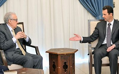 Syrian President Bashar Assad (right), speaks with UN-Arab League envoy for Syria, Lakhdar Brahimi, in Damascus, Syria, on Wednesday, October 30, 2013. (photo credit: AP/SANA)