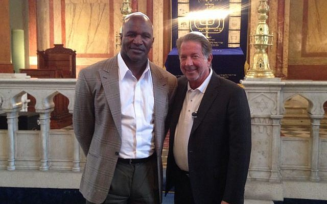 Evander Holyfield and Yank Barry in the Sofia Synagogue. (photo credit: courtesy)