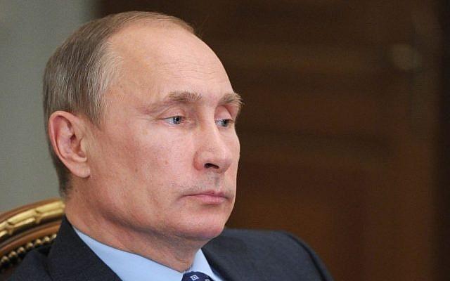 Russian President Vladimir Putin in 2013 (AP/RIA Novosti Kremlin/Mikhail Klimentyev/Presidential Press Service, File)