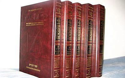 A photo of five volume The Sapirstein Edition Rashi Artscroll Chumash. (photo credit: public domain via Wikimedia Commons)