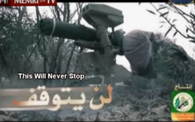 A 'Hamas fighter' preparing to launch a missile at Israel in a clip that appeared on al-Aqsa TV (screen capture: MEMRI)