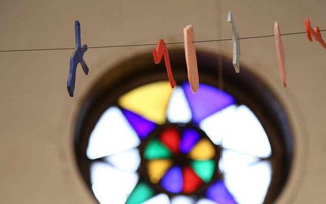 A sculpture by Thomas Nozkowski hangs in front of the stained glass window of the shul, which was not able to be saved in the renovation. (photo credit: Casimir Nozkowski)