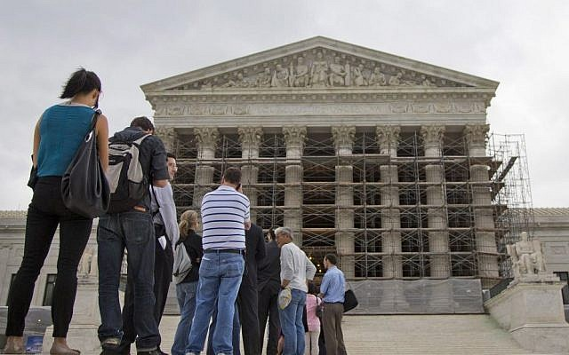 People wait in line to enter the US Supreme Court in Washington, DC (photo credit: AP/Evan Vucci/File)
