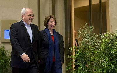 EU High Representative for Foreign Affairs Catherine Ashton, right, and Iranian Foreign Minister Mohammad Javad Zarif, arrive for a photo opportunity prior to the start of closed-door nuclear talks in Geneva, Switzerland, Wednesday, Nov. 20, 2013 (photo credit: AP/Keystone,Salvatore Di Nolfi)
