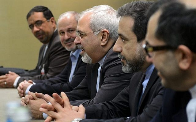 Iranian Foreign Minister Mohammad Javad Zarif, center, attends talks in Geneva on Iran's nuclear program, November 22, 2013. (photo credit: AP/Fabrice Coffrini)