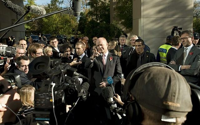 British Foreign Secretary William Hague, center, speaks to journalists during the third days of closed-door nuclear talks with Iran at the United Nations offices in Geneva Switzerland, Saturday. (AP Photo/Keystone,Martial Trezzini)