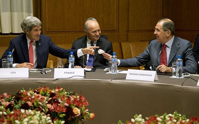 From left, US Secretary of State John Kerry, French Foreign Minister Laurent Fabius, and Russia's Foreign Minister Sergei Lavrov gather at the United Nations Palais, Sunday, November 24, 2013, in Geneva, Switzerland, during the Iran nuclear talks. (photo credit: AP/Carolyn Kaster, Pool)