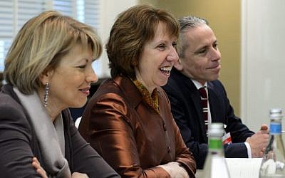 EU foreign policy chief Catherine Ashton, center, next to members of her delegation attends talks over Iran's nuclear program in Geneva on Friday Nov. 22, 2013. (photo credit: AP PhotoFabrice Coffrini,Pool)