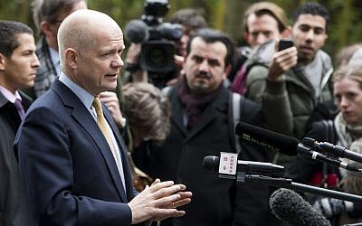 British Foreign Secretary William Hague speaks to journalists as he arrives at the Intercontinental Hotel prior to talks on Iran's nuclear program in Geneva, Switzerland, Saturday, Nov. 23, 2013. (photo credit: AP Photo/Keystone,Jean-Christophe Bott)
