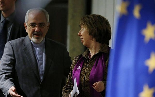 Iranian Foreign Minister Mohammad Javad Zarif, left, gestures to Catherine Ashton, the European Union's foreign policy chief, as they arrive at a press conference at the end of the Iranian nuclear talks in Geneva, Sunday, November 10, 2013 (photo credit: AP/Jason Reed, Pool)