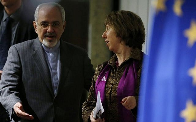 Iranian Foreign Minister Mohammad Javad Zarif gestures to Catherine Ashton, the European Union's foreign policy chief, as they arrive at a press conference at the end of the Iranian nuclear talks in Geneva, early on Sunday, Nov. 10, 2013. (photo credit: AP Photo/Jason Reed, Pool)