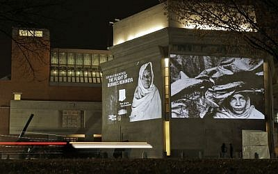 Photographs by Greg Constantine showing the plight of Burma's Rohingya people, projected on the exterior walls of the United States Holocaust Memorial Museum in Washington, Monday, Nov. 4, 2013. (photo credit: AP Photo/Alex Brandon)