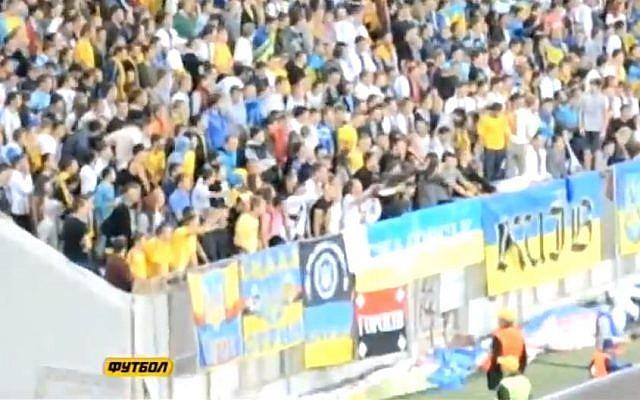 Ukrainian soccer fans doing a Nazi salute against their own team member. (Screen capture: YouTube)