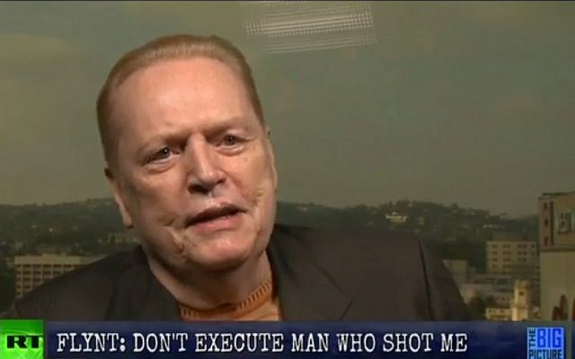 Hustler magazine publisher Larry Flynt, who was shot by neo-Nazi serial killer Joseph Paul Franklin, appears on RT calling on the state of Missouri not to put the white supremacist sniper to death. (photo credit: screen capture, YouTube)