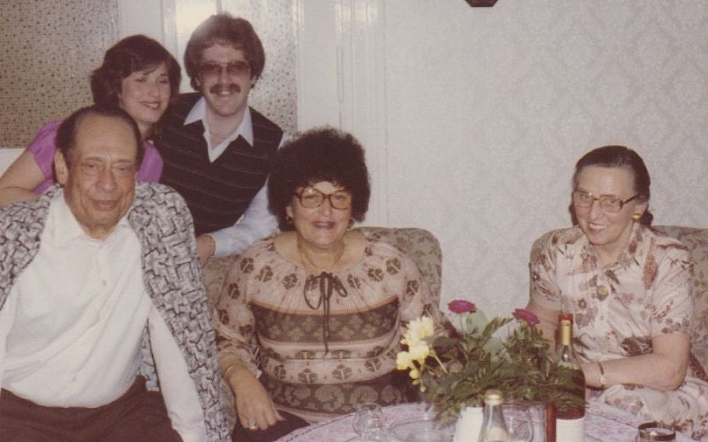 At their Berlin home in 1980, Mohamad and Emmi Helmy flank Anna Gutman; Carla Greenspan and her husband, Barry, appear behind them. (photo credit: Courtesy Carla Greenspan/JTA)