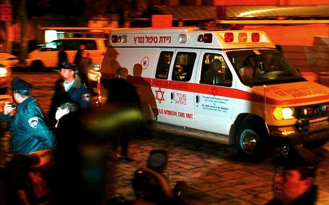 """An ambulance bearing former Prime Minister Ariel Sharon enters Hadassah Ein Kerem Hospital outside Jerusalem late on Wednesday,January 4, 2006, after Sharon complained of """"not feeling well."""" A short while after arriving a hospital spokesman announced that Sharon had suffered a """"significant stroke."""" Sharon fell into a coma, from which he has still not awoken. (Photo credit: Nati Shohat/Flash90)"""