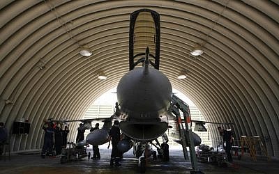 IAF soldiers prepare an F-16 for a combat sortie (photo credit: Nati Shocat/ Flash 90)