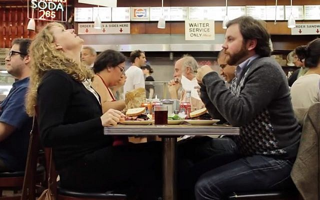 'When Harry Met Sally' gets a real-life take with a comedy improv group at Katz's Deli. (screenshot: YouTube)