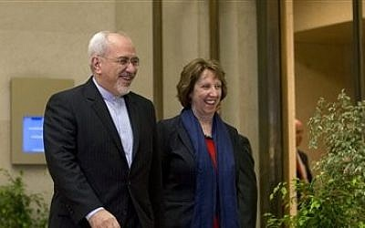 EU High Representative for Foreign Affairs Catherine Ashton, right, and Iranian Foreign Minister Mohammad Javad Zarif, arrive for a photo opportunity prior to the start of three days of closed-door nuclear talks in Geneva, Switzerland, Wednesday, Nov. 20, 2013 (photo credit: AP/Keystone,Salvatore Di Nolfi)