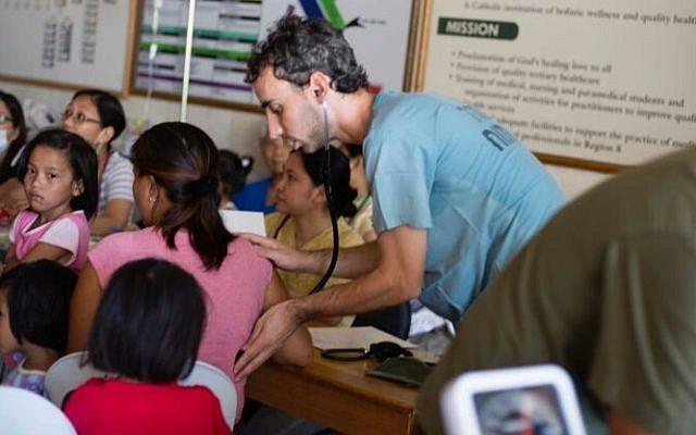 Members of IsraAID's medical team treat those affected by the typhoon. (Photo credit: IsraAID/Nufar Tagar)