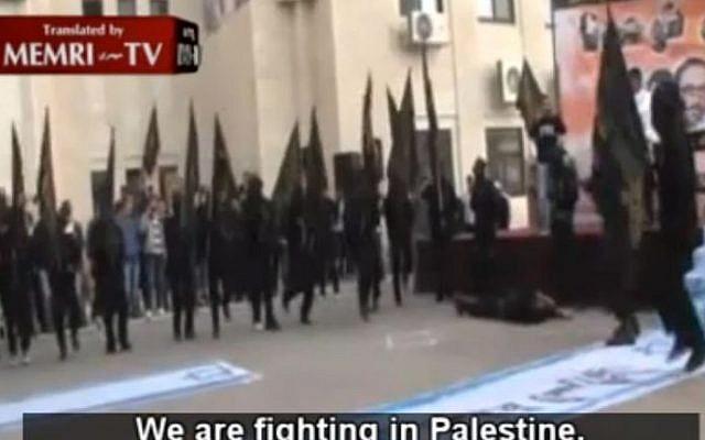 A still from a video clip of Islamic Jihad demonstrators at al-Quds University (photo credit: MEMRI screenshot)
