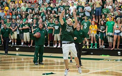 Colorado State University freshman Andrew Schneeweis sinks a half-court shot at a pep rally to win a year's free tuition. (photo credit:John Eisele/CSU Photography/JTA)