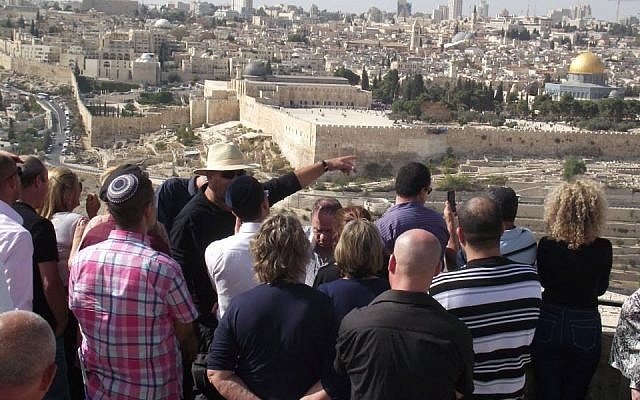 Shaul Arieli, looking at the holy basin of Jerusalem from the Mount of Olives, with Likud Central Committee members (Photo credit: Courtesy Shaul Arieli/ Facebook)