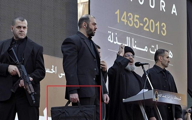 Hassan Nasrallah and his security detail at a recent appearance in Beirut (Photo credit: AP/Bilal Hussein)