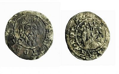 A 13th century silver penny found in Acre, the oldest coin mentioning the king of Bohemia (reverse at left, obverse at right). (photo credit: Clara Amit, IAA Photography Department)