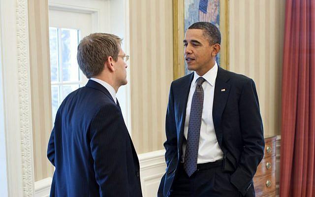 Jay Carney, left, speaking to Barack Obama. (photo credit: Pete Souza/White House)