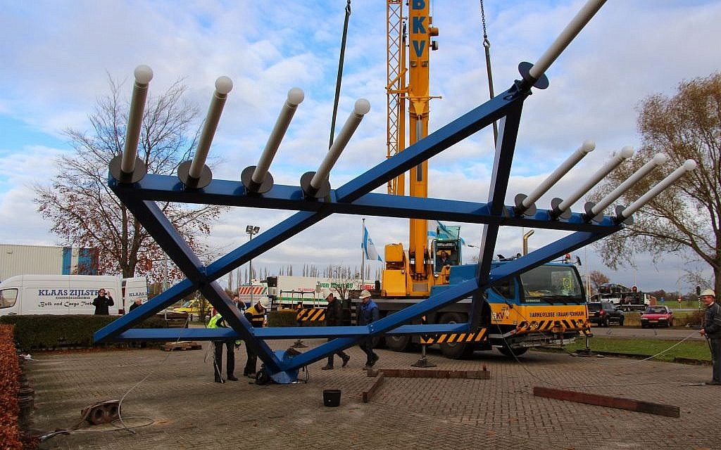 The Christians for Israel menorah being mounted in Nijkerk near Amsterdam on Nov. 25, 2013. (photo credit: Sara van Oordt, Christians for Israel/JTA)
