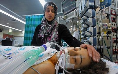 Ghadeer El Hessee from Gaza is accompanied by her mother to a heart operation at Wolfson Medical Center, near Tel Aviv, December 2011 (photo credit: David Silverman/Flash90)