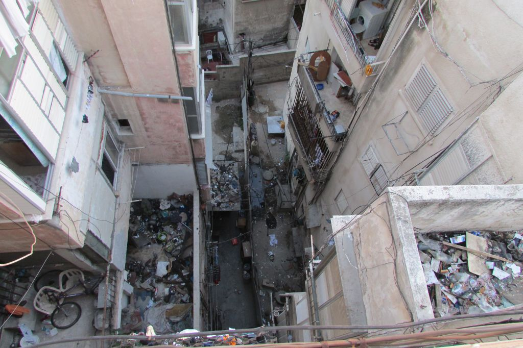Looking down from the roof of Menashe's building, the garbage and filth is obvious. (photo credit: Debra Kamin)
