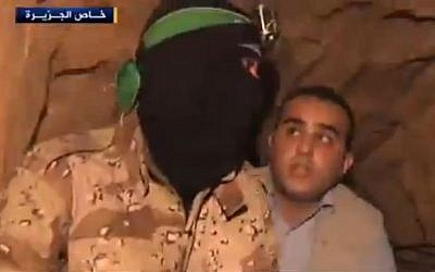 A Hamas operative taking an Al Jazeera reporter on a tour of a tunnel. (Screenshot: Al Jazeera)