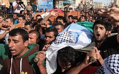 Mourners attend the funeral of Palestinian militants Khaled al-Najjar and Mussa Fanasheh on November 27, 2013 in the West Bank village of Yatta, one day after they were shot dead, along with another Palestinian activist. (photo credit: Issam Rimawi/FLASH90)