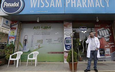 Lebanese released hostage Wissam Khatib outside his pharmacy, in Zahleh town, in the Bekaa valley, east Lebanon, Thursday, Nov. 7, 2013 (photo credit: AP)