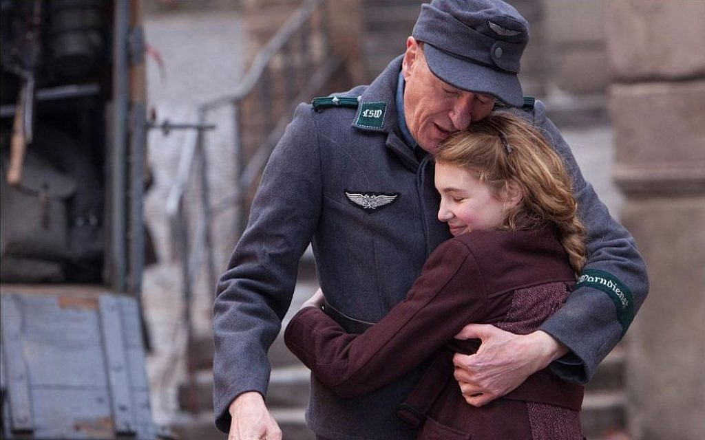 'The Book Thief' stars Geoffrey Rush as the proverbial 'Good German' and newcomer Sophie Nelisse as the young girl clinging to her innocence. (photo credit: 20th Century Fox)