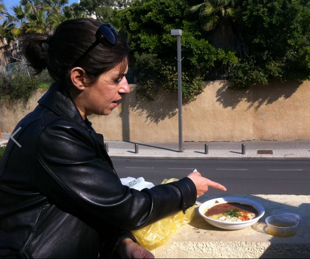 Inbal Baum can demonstrate how to swipe hummus, as well as where to find the best 'hummusiya' in the city (Courtesy Inbal Baum)