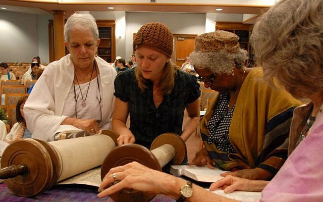 A non-Jewish woman is among those at a Torah reading at Adas Israel Congregation in Washington. Many Conservative synagogues are finding new ways for non-Jews to participate in synagogue life. (photo credit: Adas Israel/JTA)