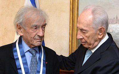 President Shimon Peres seen awarding Nobel Peace Prize recipient Elie Wiesel the Presidential Medal of Distinction, at a ceremony in New York City, November 25, 2013. (photo credit: Mark Neyman/GPO/Flash90)