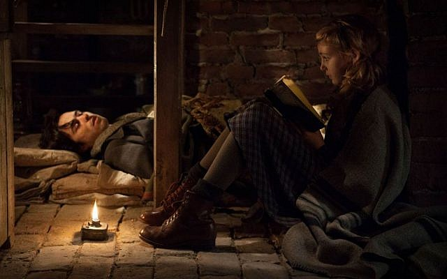Books as a symbol of identifying with Jews? Not intentional says 'Book Thief' director Brian Percival. (photo credit: 20th Century Fox)
