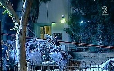 Screen capture from Channel 2 showing the aftermath of a car explosion in Tel Aviv on November 7, 2013. The target of the attack was a top state prosecutor.
