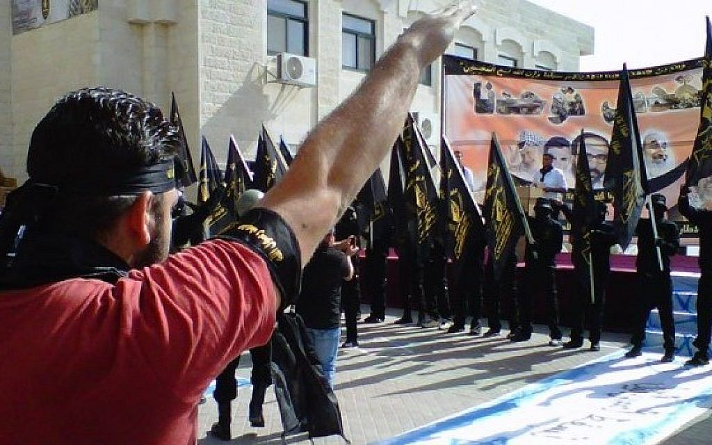 A photo showing a rally with anti-Semitic symbols at al-Quds University on November 5, 2013. (photo credit: Courtesy)