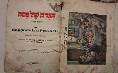A 1930 Viennese haggadah recovered from Baghdad BEFORE preservation. (photo credit: The National Archives)
