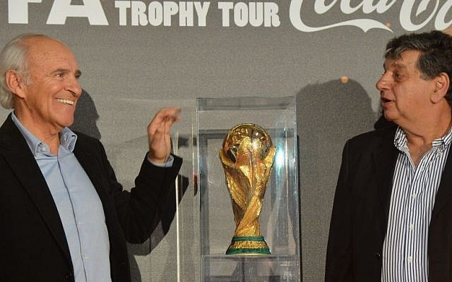 Former Israeli soccer player Mordechai Spiegler (L) with Itzhak Shum stand beside the FIFA World Cup, in Tel Aviv, Israel, November 10, 2013 (photo credit: Yossi Zeliger/Flash90)