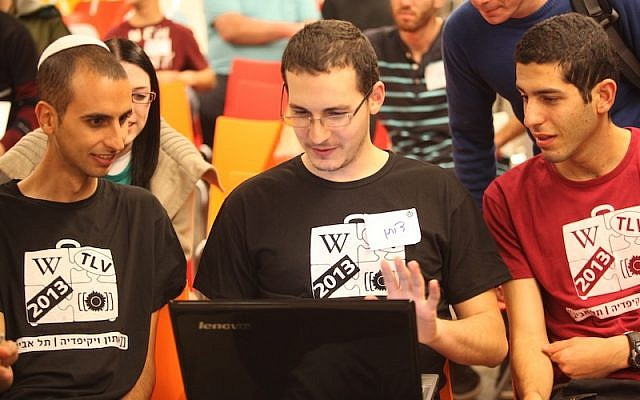 Hackers work on apps and bug fixes at the Wikimedia Israel Hackathon (Photo credit: Courtesy)