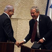 US president George W. Bush shake hands with Benjamin Netanyahu, head of the opposition, at the Knesset on May 15, 2008. Bush delivered a speech to mark the Jewish state's 60th birthday. (Photo credit: Lior Mizrahi/pool/FLASH90)