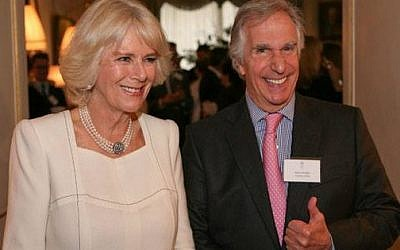 Henry Winkler gives a Fonz-like thumbs up as he poses with Camilla, Duchess of Cornwall after being honored by Britain's National Literacy Trust. (photo credit: Courtesy of Camilla, Duchess of Cornwall Facebook page)