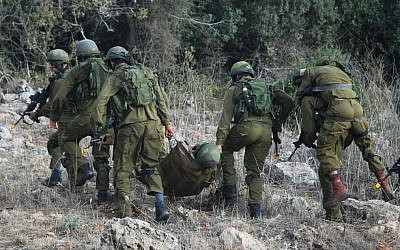IDF troops practicing the evacuation of a wounded soldier on a sling-like stretcher (photo credit: IDF Spokesperson's Unit)