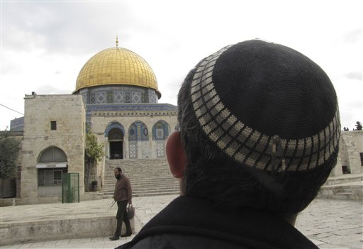 In this Monday, December 9, 2013 photo, a Jewish man looks towards the Dome of the Rock in Jerusalem. (photo credit: AP Photo/Simone Camilli)